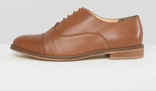 Scarpe stringate Asos, brogue marroni: 46.99 euro.